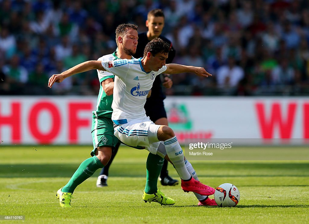 Philipp Bargfrede (L) of Bremen and Leon Goretzka of Schalke battle for the ball during the Bundesliga match between SV Werder Bremen and Schalke 04 at Weserstadion on August 15, 2015 in Bremen, Germany.