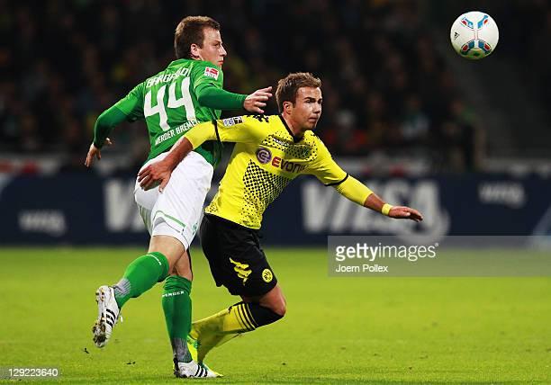 Philipp Bargfrede of Bremen and Mario Goetze of Dortmund battle for the ball during the Bundesliga match between Werder Bremen and Borussia Dortmund...
