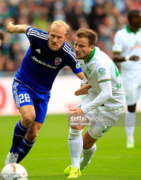 Philipp Bargfrede of Bremen challenges Tobias Levels of Ingolstadt during the Bundesliga match between Werder Bremen and FC Ingolstadt at...