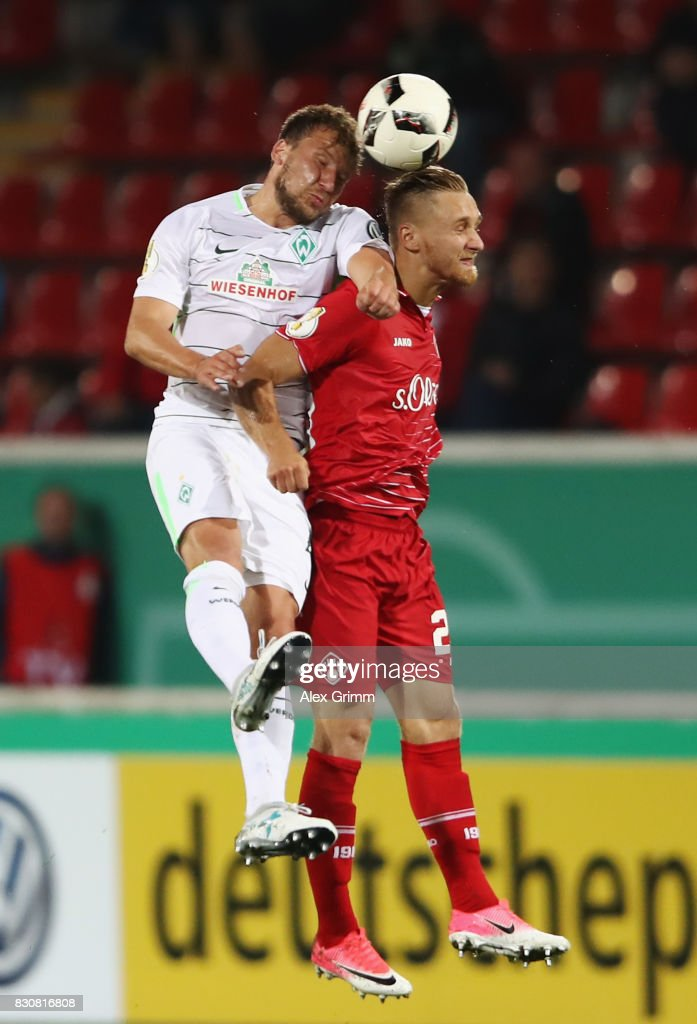 Philipp Bargfrede ((div)) of Bremen jumps for a header with Bjoern Jopek of Wuerzburg during the DFB Cup first round match between Wuerzburger Kickers and SV Werder Bremen at Sparda-Bank-Hessen-Stadion on August 12, 2017 in Offenbach, Germany.