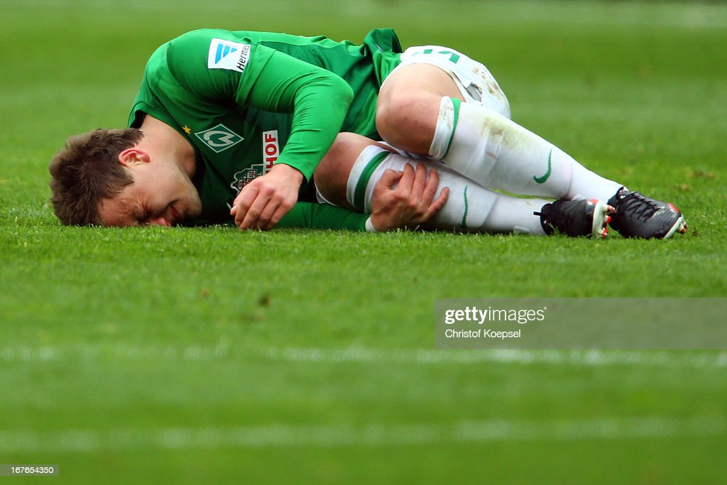 Philipp Bargfrede of Bremen lies on the pitch during the Bundesliga match between Bayer 04 Leverkusen and SV Werder Bremen at BayArena on April 27, 2013 in Leverkusen, Germany.