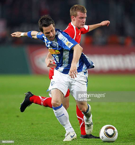 Philipp Boenig of Bochum is challenged by Daniel Brosinski of Koeln during the Bundesliga match between 1 FC Koeln and VfL Bochum at...