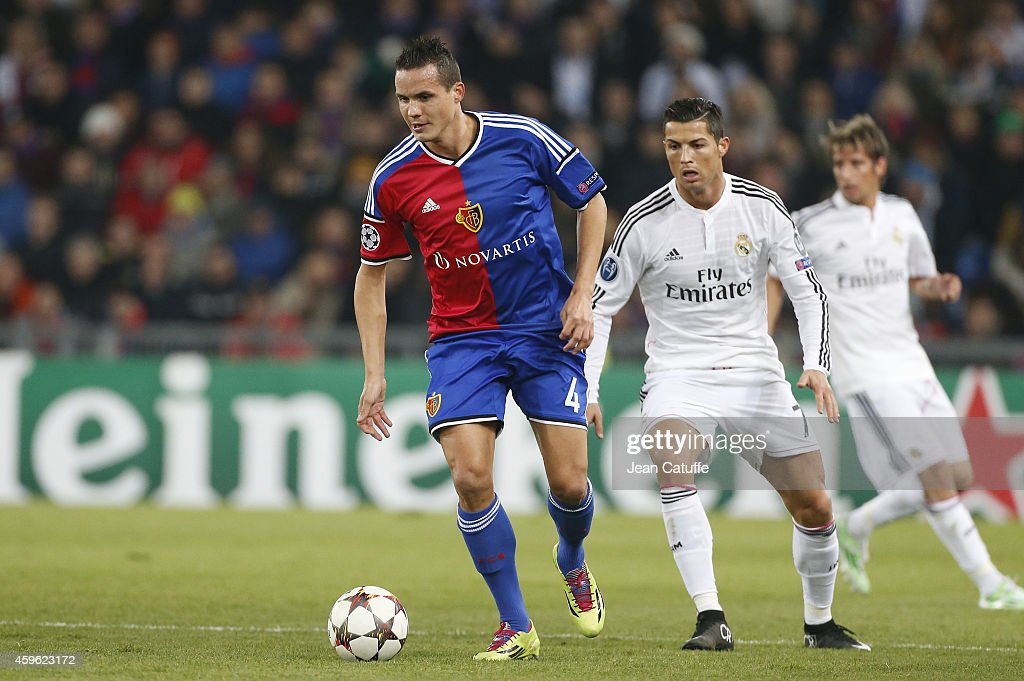 <a gi-track='captionPersonalityLinkClicked' href=/galleries/search?phrase=Philipp+Degen&family=editorial&specificpeople=534432 ng-click='$event.stopPropagation()'>Philipp Degen</a> of FC Basel and <a gi-track='captionPersonalityLinkClicked' href=/galleries/search?phrase=Cristiano+Ronaldo+-+Soccer+Player&family=editorial&specificpeople=162689 ng-click='$event.stopPropagation()'>Cristiano Ronaldo</a> of Real Madrid in action during the UEFA Champions League Group B match between FC Basel 1893 and Real Madrid CF at St. Jakob-Park stadium on November 26, 2014 in Basel, Basel-Stadt, Switzerland.