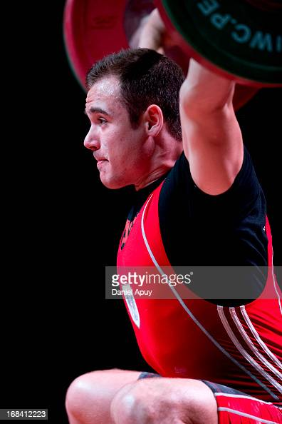 Philipp Forster of Austria B competes in Men's 94kg snatch during day six of the 2013 Junior Weightlifting World Championship at Maria Angola...