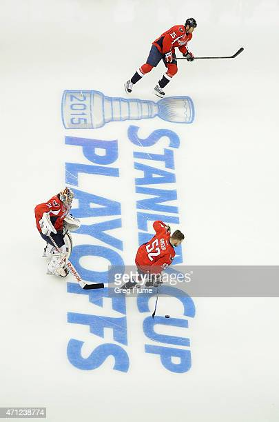 Philipp Grubauer Mike Green and Jason Chimera of the Washington Capitals warm up before the game against the New York Islanders during Game Two of...