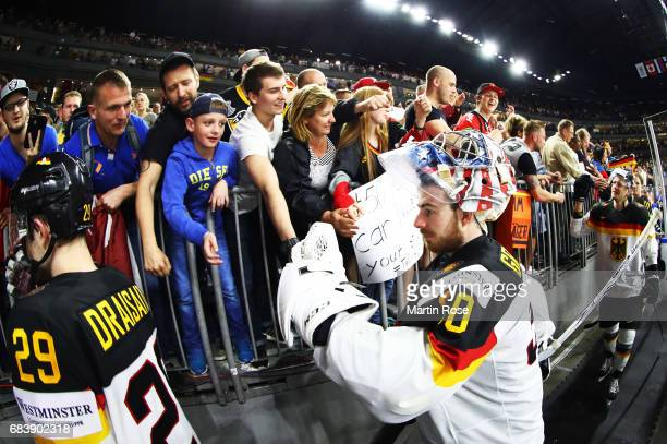 Philipp Grubauer of Germany celebrates with fans after victory in the Germany v Latvia match of the 2017 IIHF Ice Hockey World Championships at...