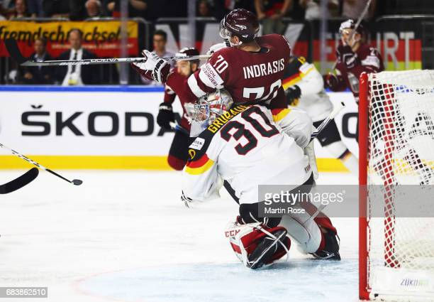 Philipp Grubauer of Germany collides with Miks Indrasis of Latvia during the Germany v Latvia match of the 2017 IIHF Ice Hockey World Championships...