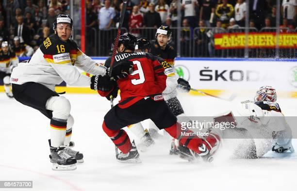Philipp Grubauer of Germany is challenegd by Matt Duchene of Canada during the 2017 IIHF Ice Hockey World Championship Quarter Final game between...