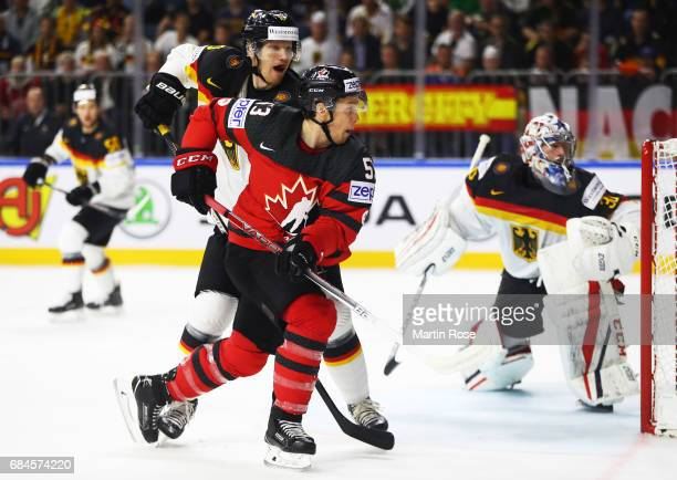 Philipp Grubauer of Germany is challenged by Jeff Skinner of Canada during the 2017 IIHF Ice Hockey World Championship Quarter Final game between...