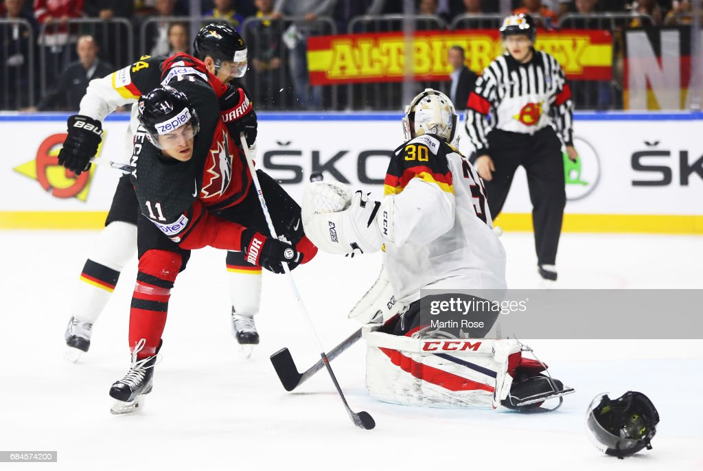 Philipp Grubauer of Germany is challenged by Travis Konecny of Canada during the 2017 IIHF Ice Hockey World Championship Quarter Final game between Canada and Germany at Lanxess Arena on May 18, 2017 in Cologne, Germany.