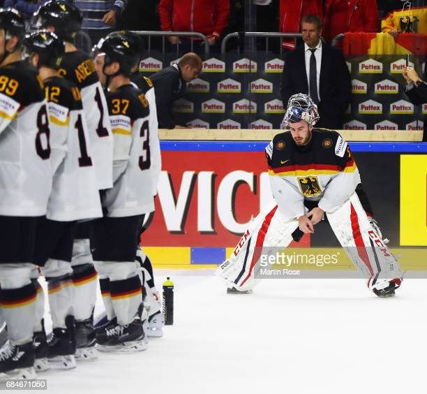 Philipp Grubauer of Germany is dejected after losing the 2017 IIHF Ice Hockey World Championship Quarter Final game between Canada and Germany at...