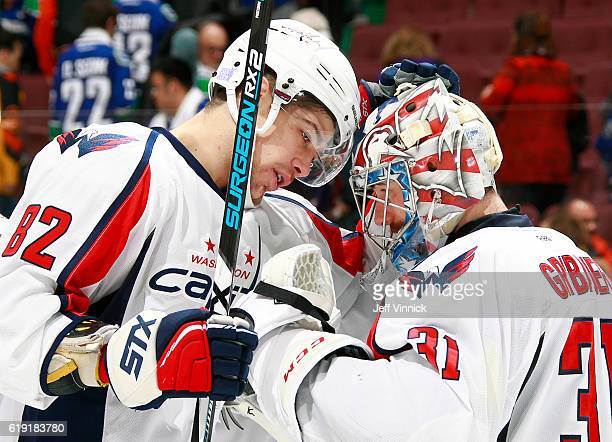 Philipp Grubauer of the Washington Capitals is congratulated by teammate Zachary Sanford after their NHL game against the Vancouver Canucks at Rogers...