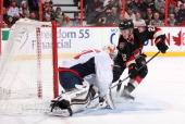 Philipp Grubauer of the Washington Capitals makes a save against Erik Condra of the Ottawa Senators during an NHL game at Canadian Tire Centre on...