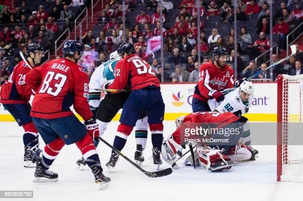 Philipp Grubauer of the Washington Capitals makes a save against Kevin Labanc of the San Jose Sharks in the second period at Capital One Arena on...