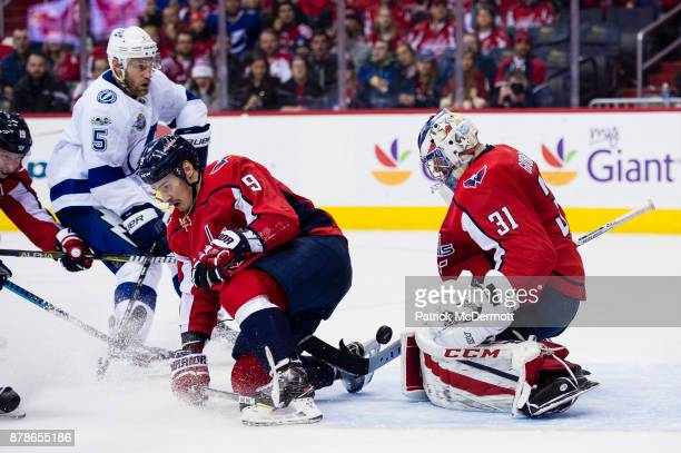 Philipp Grubauer of the Washington Capitals makes a save against the Tampa Bay Lightning in the second period at Capital One Arena on November 24...