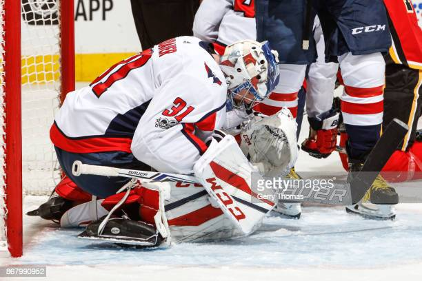 Philipp Grubauer of the Washington Capitals makes a save in an NHL game against the Calgary Flames at the Scotiabank Saddledome on October 29 2017 in...