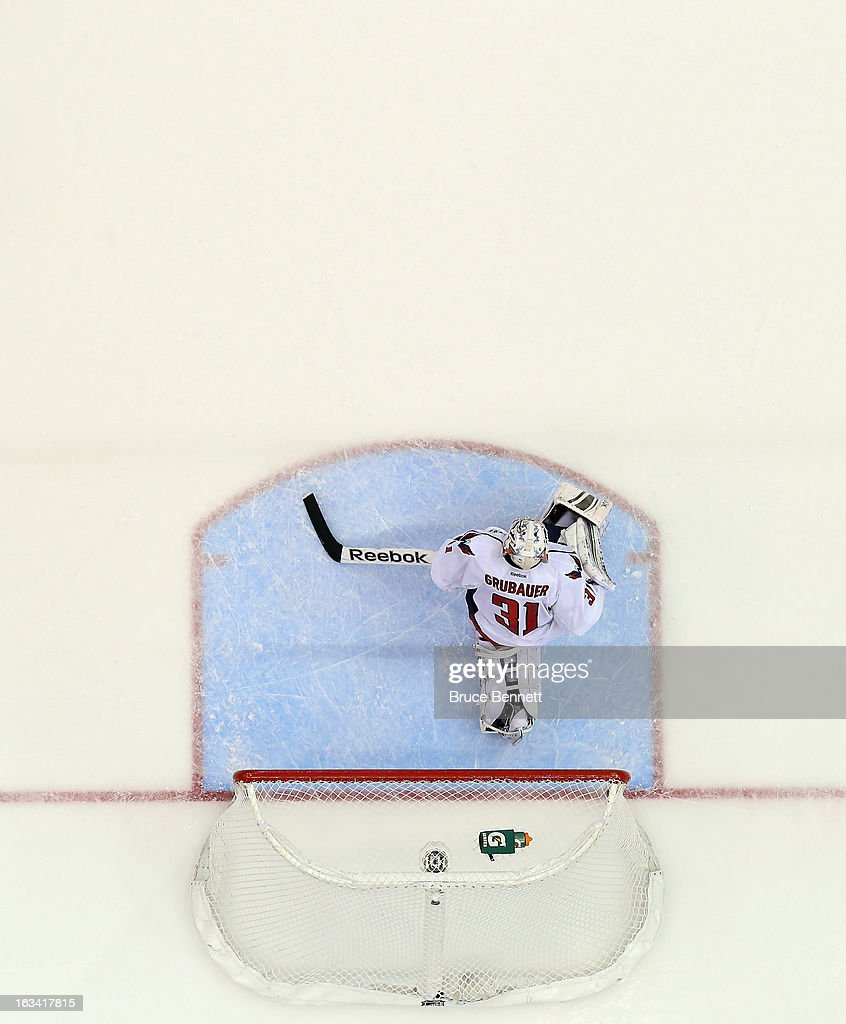 Philipp Grubauer #31 of the Washington Capitals pauses in the net following the game winning goal by <a gi-track='captionPersonalityLinkClicked' href=/galleries/search?phrase=John+Tavares&family=editorial&specificpeople=601791 ng-click='$event.stopPropagation()'>John Tavares</a> #91 of the New York Islanders at 12:13 of the third period at the Nassau Veterans Memorial Coliseum on March 9, 2013 in Uniondale, New York. The Islanders defeated the Capitals 5-2.