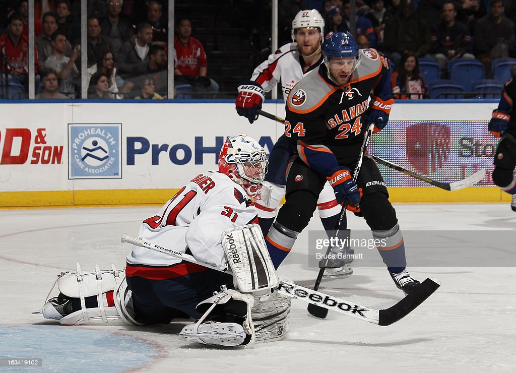 Philipp Grubauer #31 of the Washington Capitals sticks aside a shot in the game against the New York Islanders at the Nassau Veterans Memorial Coliseum on March 9, 2013 in Uniondale, New York. The Islanders defeated the Capitals 5-2.