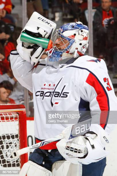 Philipp Grubauer of the Washington Capitals takes a break in an NHL game against the Calgary Flames at the Scotiabank Saddledome on October 29 2017...