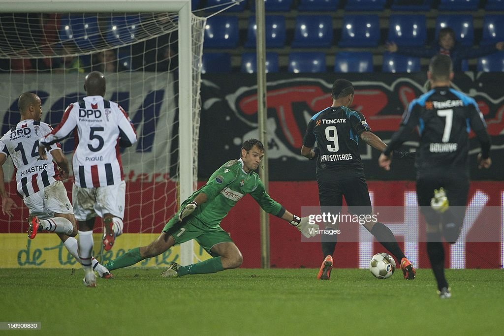 Philipp Haastrup of Willem II, Mitchell Pique of Willem II, goalkeeper David Meul of Willem II, Samuel Armenteros of Heracles Almelo, Ninos Gouriye of Heracles Almelo during the Dutch Eredivisie match between Willem II and Heracles Almelo at the Koning Willem II Stadium on November 24, 2012 in Tilburg, The Netherlands.