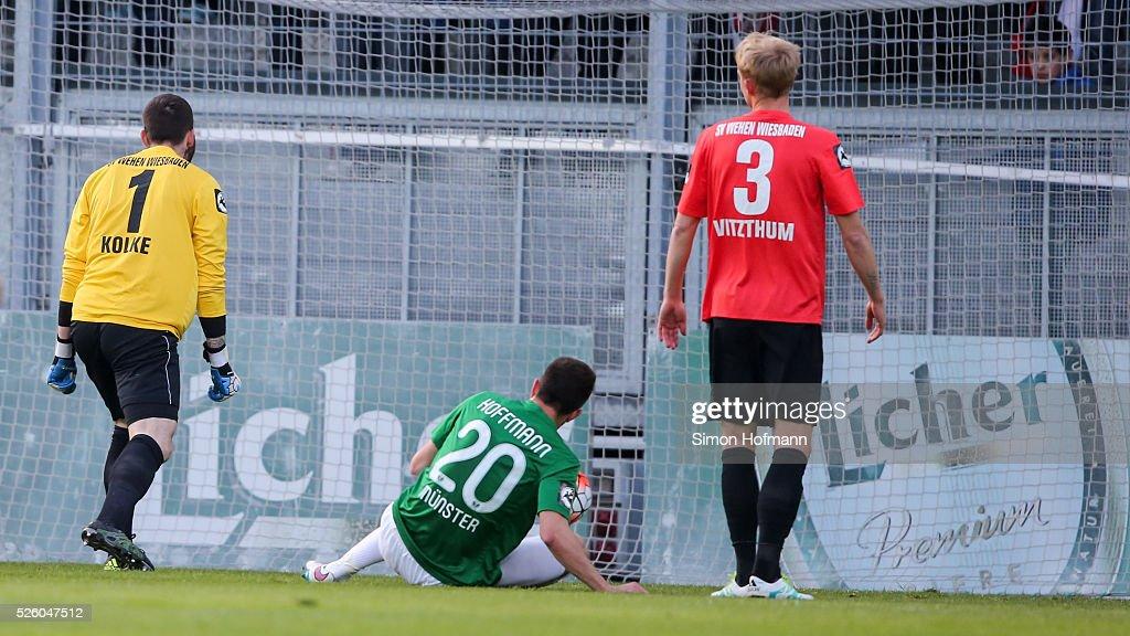 Philipp Hoffmann of Muenster scores his team's first goal against goalkeeper Markus Kolke of Wiesbaden during the Third League match between Wehen Wiesbaden and Preussen Muenster at BRITA-Arena on April 29, 2016 in Wiesbaden, Hesse.