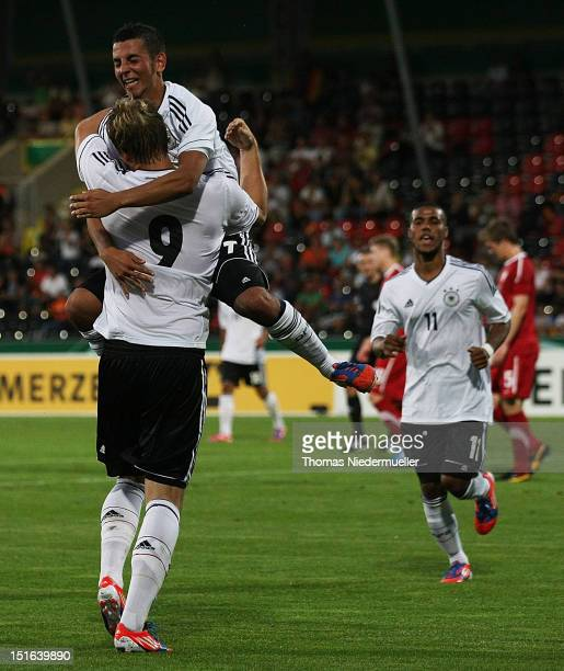 Philipp Hofmann celebrates his goal with his teammate Julian Derstroff of Germany during the Under 20 International Friendly match between Germany...