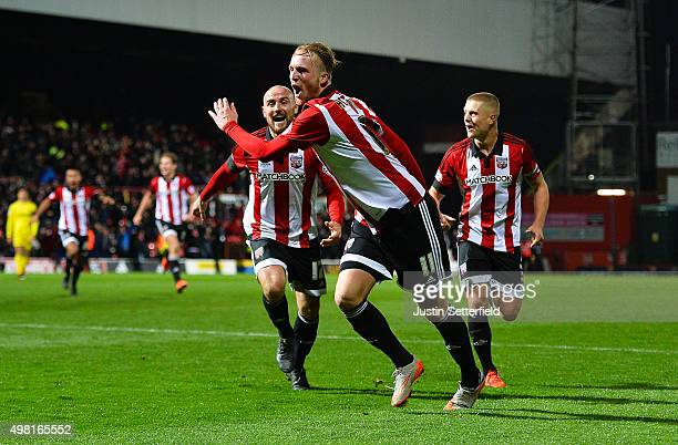 Philipp Hofmann of Brentford celebrates scoring the winning goal during the Sky Bet Championship match between Brentford and Nottingham Forest at...