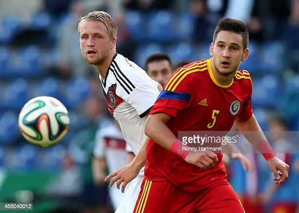 Philipp Hofmann of Germany and Deian Boldor of Romania head for the ball during the U21 Germany v U21 Romania 2015 UEFA European U21 Championships...