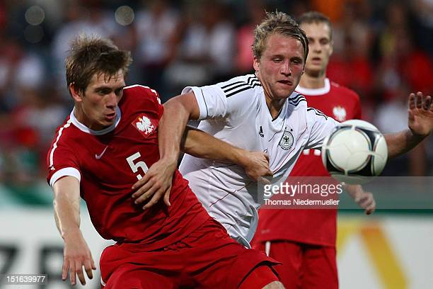Philipp Hofmann of Germany fights for the ball with Michal Nalepa of Poland during the Under 20 International Friendly match between Germany and...