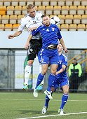 Philipp Hofmann of Germany jumps for a header with Andras Vagsheyg of Faroe Islands during the UEFA Under21 Euro 2015 Qualifier match between Faroe...