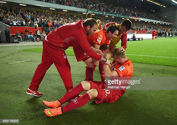 Philipp Hofmann of Kaiserslautern celebrates with his teammates after scoring his team's third goal during during the Second Bundesliga match between...