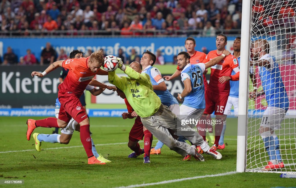 Philipp Hofmann (L) of Kaiserslautern scores his team's third goal past Gabor Kiraly of 1860 Muenchen during the Second Bundesliga match between 1. FC Kaiserslautern and TSV 1860 Muenchen at Fritz-Walter-Stadion on August 4, 2014 in Kaiserslautern, Germany.