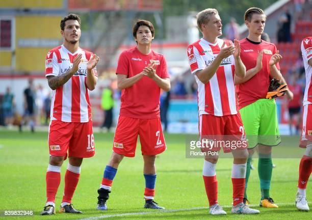 Philipp Hosiner Atsuto Uchida Felix Kroos and Daniel Mesenhoeler of 1FC Union Berlin after the game between Union Berlin and Arminia Bilefeld on...