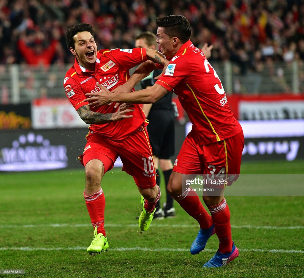 Philipp Hosiner of Berlin celebrates scoring his goal with Fabian Schnheim during the Second Bundesliga match between 1. FC Union Berlin and 1. FC Nuernberg at Stadion An der Alten Foersterei on March 20, 2017 in Berlin, Germany.