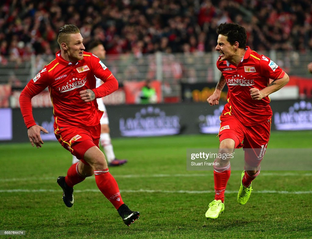 Philipp Hosiner of Berlin celebrates scoring his goal with Sebastian Polter during the Second Bundesliga match between 1. FC Union Berlin and 1. FC Nuernberg at Stadion An der Alten Foersterei on March 20, 2017 in Berlin, Germany.