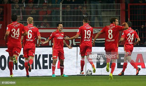 Philipp Hosiner of Berlin jubilates with team mates after scoring the first goal during the Second Bundesliga match between 1 FC Union Berlin and FC...