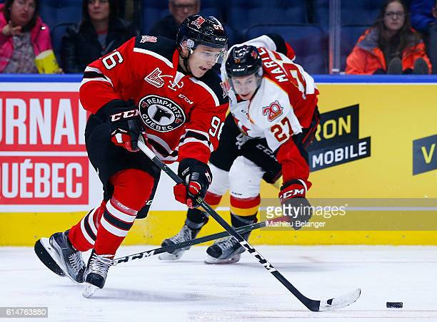 Philipp Karashev of the Quebec Remparts skates with the puck against the Baie Comeau Drakkar during their QMJHL hockey game at the Centre Videotron...