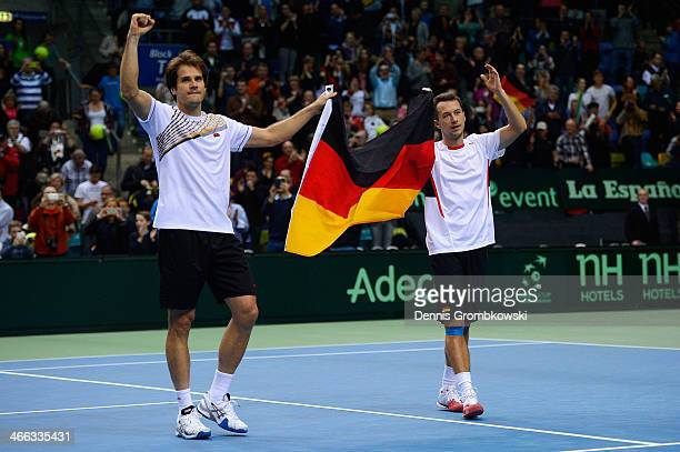 Philipp Kohlschreiber and Tommy Haas of Germany celebrate after winning their double match against Fernando Verdasco and David Marrero of Spain on...