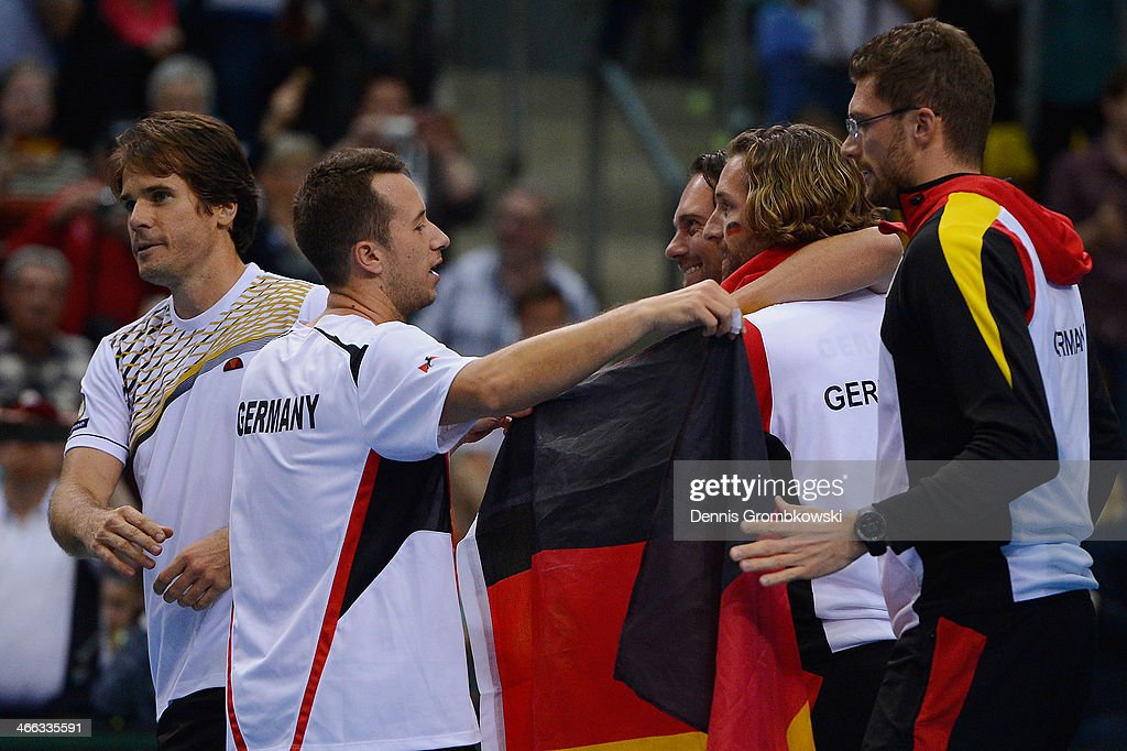 Philipp Kohlschreiber and Tommy Haas of Germany celebrate with teammates after winning their double match against Fernando Verdasco and David Marrero...