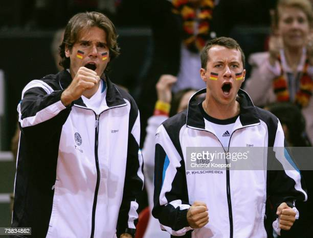 Philipp Kohlschreiber and Tommy Haas with painted faces cheer for their team mates Michael Kohlmann and Alexander Waske during their double against...