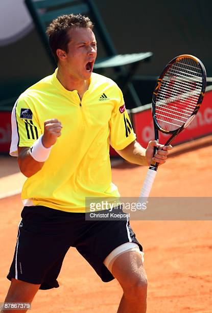 Philipp Kohlschreiber of Germany celebrates his 67 63 and 63 victory against JoWilfried Tsonga of France during day four of the ARAG Team World Cup...