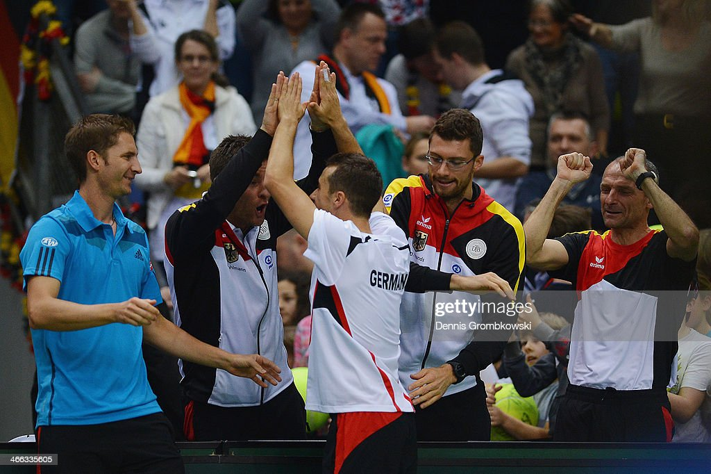 Philipp Kohlschreiber of Germany celebrates with teammates after winning their double match against Fernando Verdasco and David Marrero of Spain on...