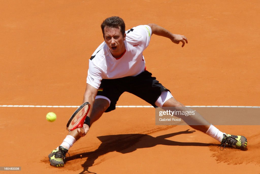 Philipp Kohlschreiber of Germany hits the ball during the first match of the series between Argentina and Germany in the first round of Davis Cup at Parque Roca Stadium on February 01, 2013, Buenos Aires, Argentina.