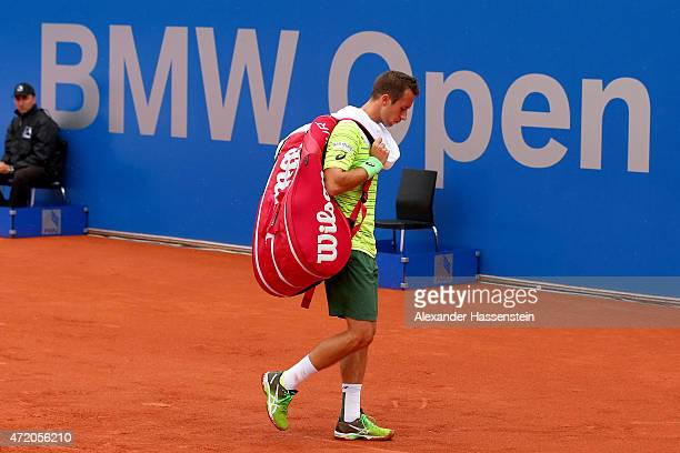 Philipp Kohlschreiber of Germany leaves the centre court during a rain delay prior to the BMW Open final between Andy Murray of Great Britain and...