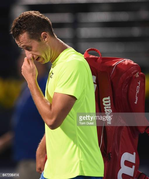 Philipp Kohlschreiber of Germany leaves the court after loosing his quarter final match against Andy Murray of Great Britain on day five of the ATP...