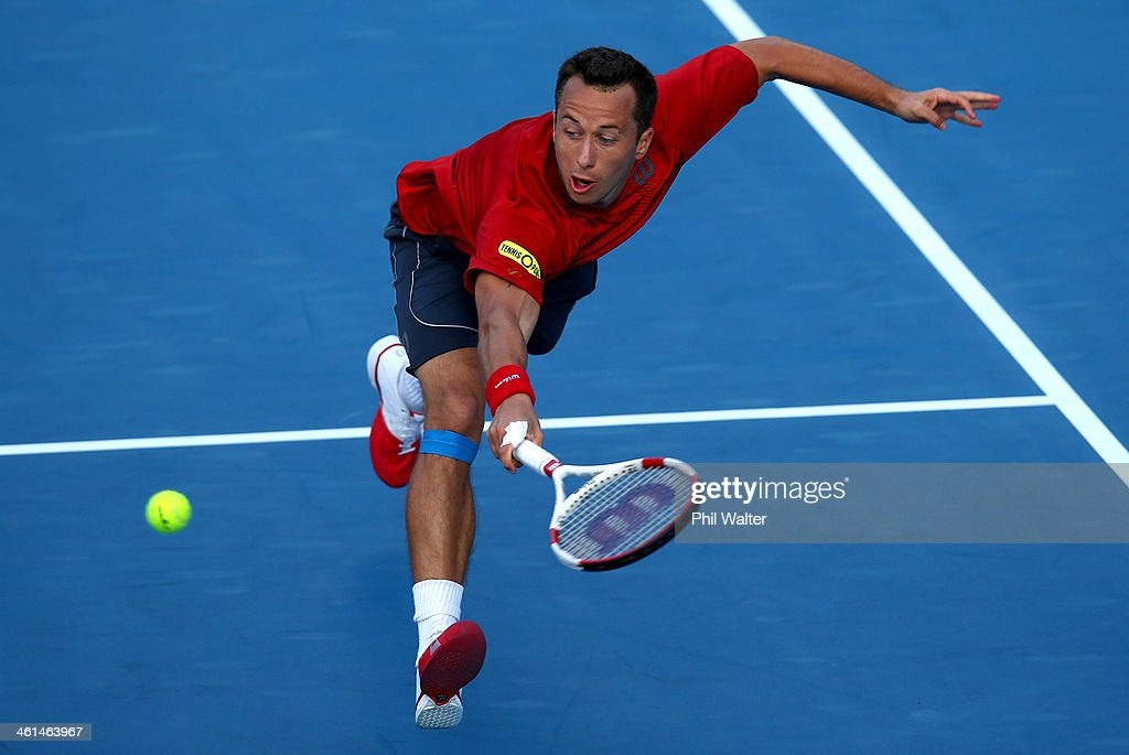 <a gi-track='captionPersonalityLinkClicked' href=/galleries/search?phrase=Philipp+Kohlschreiber&family=editorial&specificpeople=225202 ng-click='$event.stopPropagation()'>Philipp Kohlschreiber</a> of Germany plays a backhand against John Isner of the USA during day four of the Heineken Open at ASB Tennis Centre on January 9, 2014 in Auckland, New Zealand.