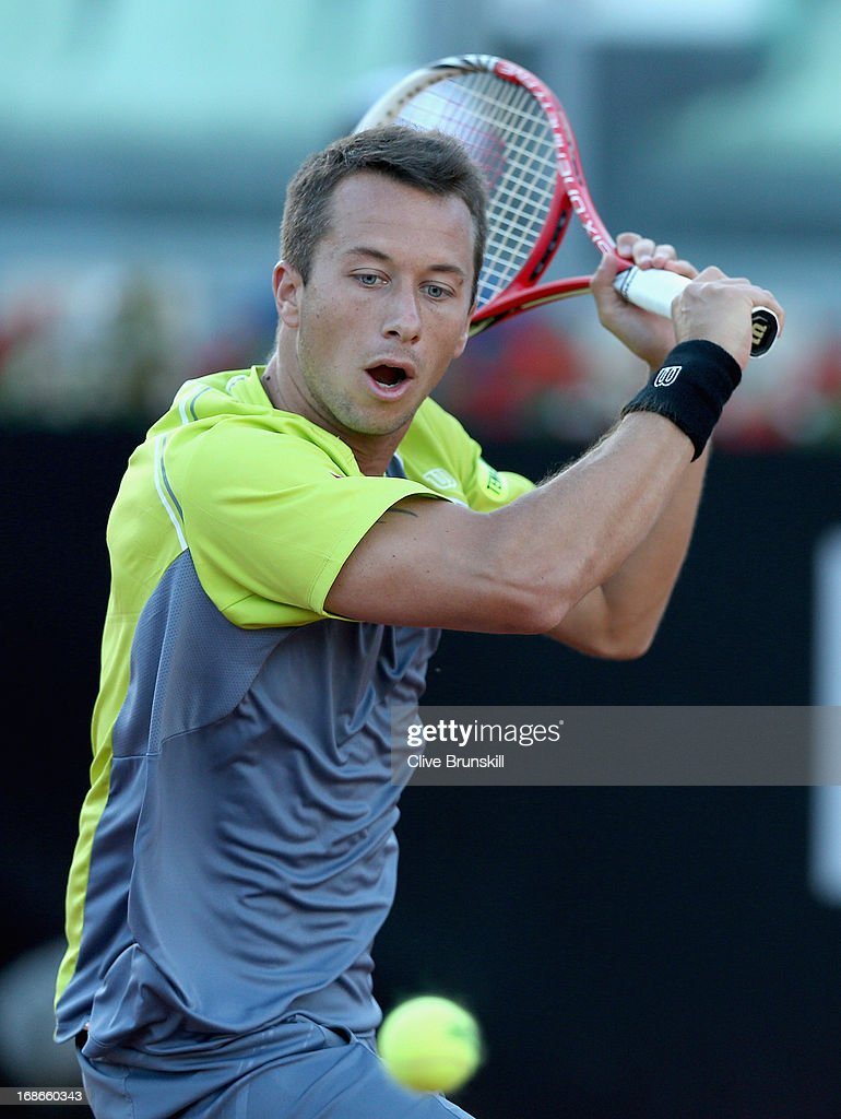 Philipp Kohlschreiber of Germany plays a backhand against Milos Raonic of Canada in their first round match during day two of the Internazionali BNL d'Italia 2013 at the Foro Italico Tennis Centre on May 13, 2013 in Rome, Italy.