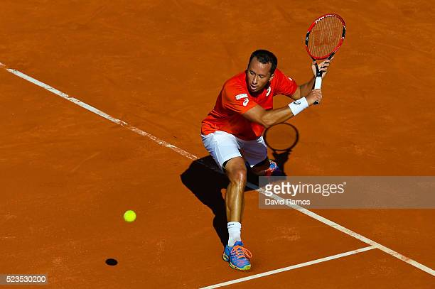 Philipp Kohlschreiber of Germany plays a backhand against Rafael Nadal of Spain during day six of the Barcelona Open Banc Sabadell at the Real Club...
