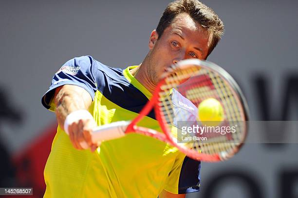 Philipp Kohlschreiber of Germany plays a backhand during his match against Janko Tipsarevic of Serbia during day six of Power Horse World Team Cup at...