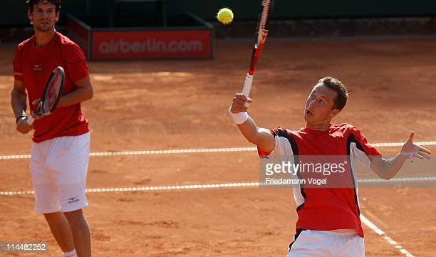 Philipp Kohlschreiber of Germany plays a backhand during the final doubles match between Philipp Kohlschreiber with Philipp Petzschner of Germany and...